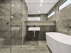 lovely looking bathroom wall and floor tiled